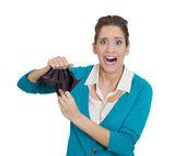 Shocked girl holding empty wallet — Stock Photo
