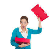 Dumbfounded woman opening red gift box — Stock Photo