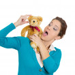 Woman dancing teddy bear — Stockfoto