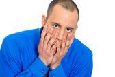 Stressed young man with hands on face — Stockfoto