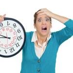 Woman holding clock — Stock Photo #39330145