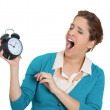 Stock Photo: Yawning womholding clock