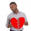 Man holding broken heart — Stock Photo