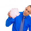 Stock Photo: Mholding empty piggy bank