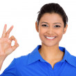 Smiling woman giving OK sign — Stock Photo