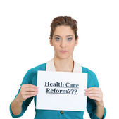 Woman holding a sign healthcare reform — Stock Photo