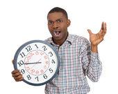 Uomo che tiene un orologio — Foto Stock