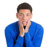 Man dragging cheeks down — Stock Photo