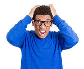 Angry nerdy young man — Stock Photo