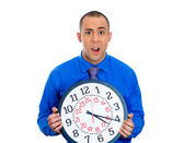 Man holding a clock — Stockfoto
