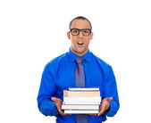 Nerdy man holding books — Foto Stock