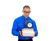 Nerdy man holding books — Stockfoto