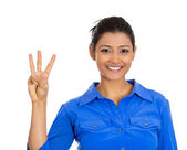 Woman giving a three fingers sign — Stock Photo