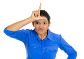 Woman displaying loser sign — Stock Photo