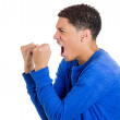Stock Photo: Angry mwith fists in air, wide open mouth yelling