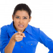 Woman pointing at someone as if to say you did something wrong — Stock Photo