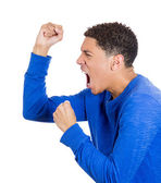 Angry man with fists in air — Stock Photo