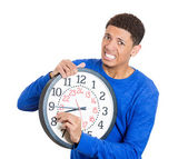 Man holding a clock very stressed — Stok fotoğraf