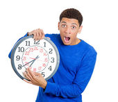 Man holding a clock very stressed — Stockfoto