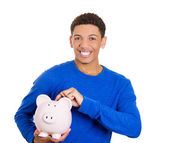 Man holding piggy bank — Stock Photo