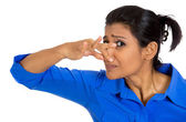 Woman covering nose — Stock Photo