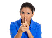 Woman placing finger on lips, pointing at you as if to say, shhhhh, quiet — Stock Photo
