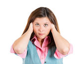 Woman covering ears — Stock Photo