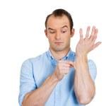Man pinching his skin — Stock Photo #40565321