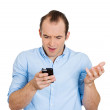 Surprised man with phone — Stock Photo