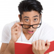 Stock Photo: Shocked mreading