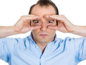 Serious man peeking — Stock Photo