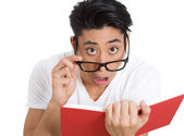 Shocked man reading — Stock Photo