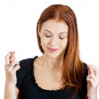 Woman crossing fingers — Stock Photo