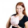 Stock Photo: Happy womholding piggy bank