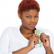 Stock Photo: Womprotecting her cash