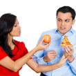 Stock Photo: Womconvincing mto eat healthy food