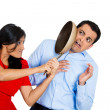Woman hitting man with pan — Stock Photo