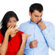 Woman looking at man closing, covering nose — Stock Photo