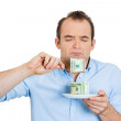 Stock Photo: Greedy womeating cash