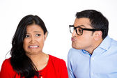 Nerdy man trying to kiss snobby woman — Stockfoto