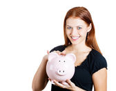 Happy woman holding piggy bank — Stock Photo
