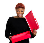 Excited woman opening gift box — Stock Photo