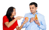 Woman trying to convince man to eat healthy food — Stock Photo