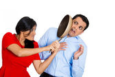 Woman hitting man with pan — Stock Photo
