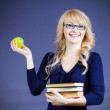 Woman holding pile of text books — Stock Photo #43517947
