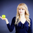 Woman holding green fresh apple — Stock Photo