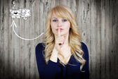 Woman placing finger hand on lips shhh sign — Stockfoto