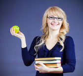 Woman holding pile of text books — Stock Photo