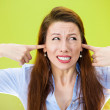 Stressed woman covering her ears — Stock Photo