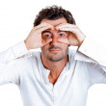 Curious man peeking through his fingers like binoculars — Stock Photo #43525273